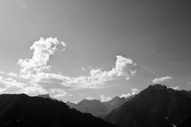 mountain peaks and clouds overhead