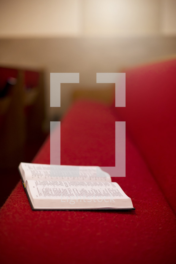 open Bible in a church pew