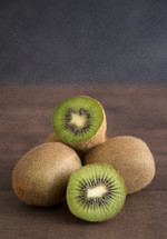 kiwi fruit on a wood table