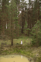 a young woman alone in a forest