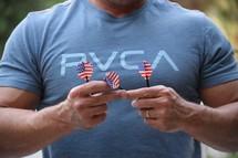a man holding darts