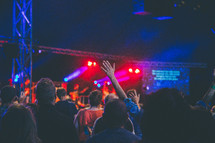 raised hands and praising God at a worship service