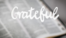 word grateful over an open Bible