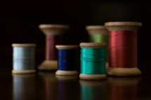 spools of brightly colored thread