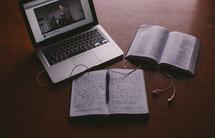 laptop computer, earbuds, open journal, journal, open Bible, Bible, pages, desk