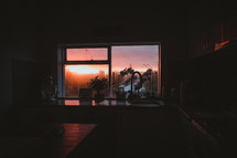 view of setting sun through a window