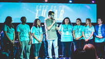 young people on stage during a worship service