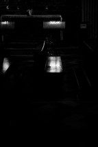 bench in a dark cathedral