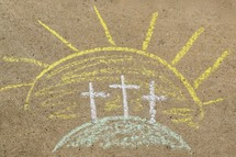 Three Easter crosses at sunrise on the mount sidewalk chalk drawing