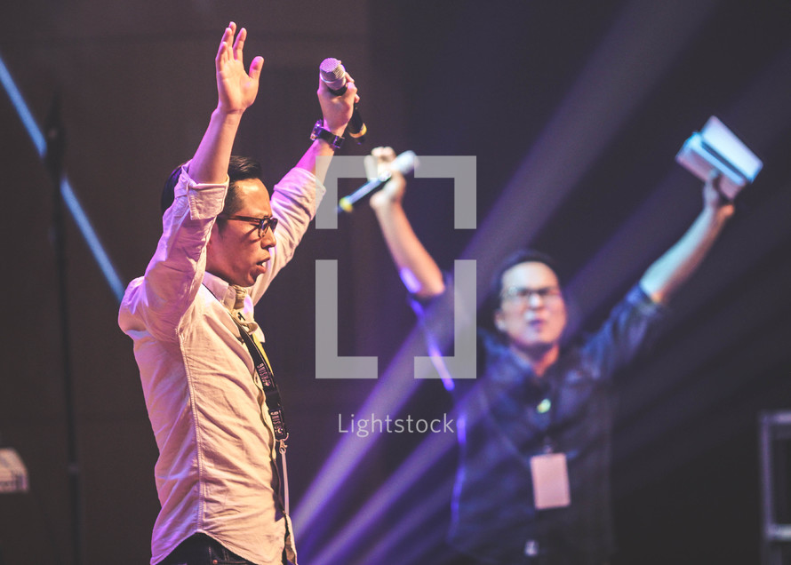 worship leaders with raised hands