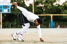 a man in the running stance on a football field