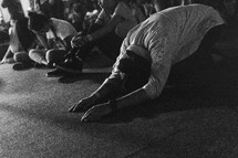 Kneeling down in prayer during an altar call