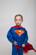 a boy child in a superman costume