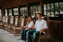 couple sitting in rocking chairs