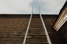 fire escape ladder hanging from a roof