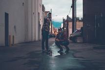 men standing in an alley talking