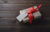 simple gift wrapped in brown paper and a red ribbon