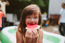 girl child eating a watermelon