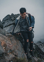 a man taking pictures on a mountaintop