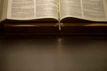 cross necklace bookmark in a Bible