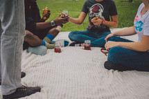 friends having a picnic on a blanket