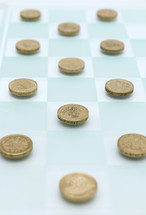 coins on a checker board