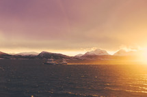 boat, ocean, water, snow, mountain peaks, mountains, outdoors, sky, sunset