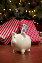 cash in a piggy bank and a Christmas tree