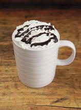 mug with whipped cream and chocolate syrup