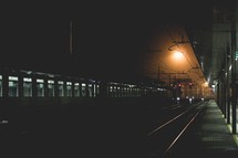 train at a train station at night