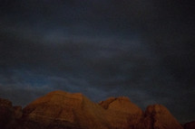 clouds over red rock mountains