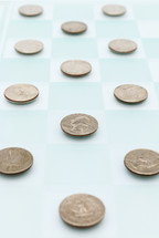 quarters on a checker board