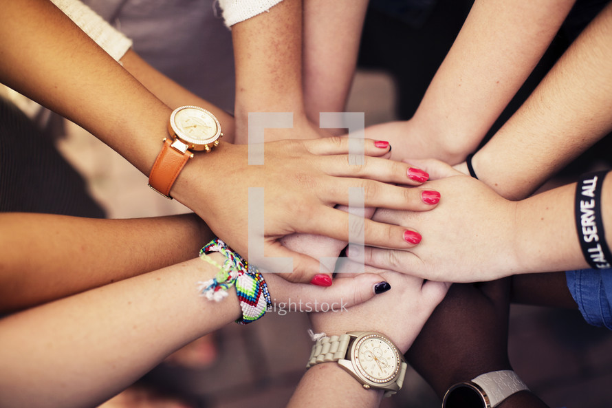 all hands in, women's group