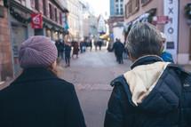 people walking down a crowded walkway