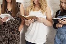 torsos of young women at a Bible study