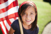 girl child holding an American flag