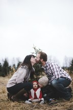 family Christmas portrait in a Christmas tree lot