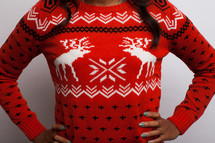 woman in a Christmas sweater