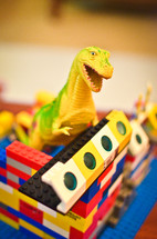 toy dinosaur in a lego house