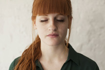 young red headed woman with closed eyes