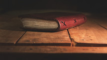 leather bound journal on wood floor