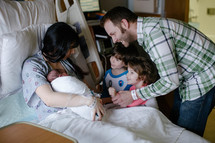 siblings meeting their new baby brother in the hospital