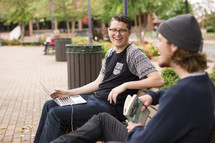 college students waiting on a bench