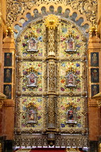 Detailed artwork on golden doors or 'beautiful gates'  leading through the 'templon' to the altar in a Russian Orthodox Church