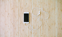 iPhone with earbuds