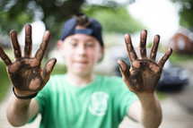 boy with dirty hands
