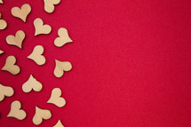 wood heart cutouts on red
