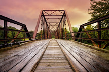 old rusty steel and wooden bridge