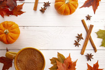 A Fall Themed Border with Real Leaves Pumpkins Spices and Hot Latte