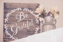 Be Grateful sign and magnolia flowers in a galvanized milk jug